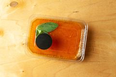 Orange jelly with mint. On wooden table royalty free stock photos