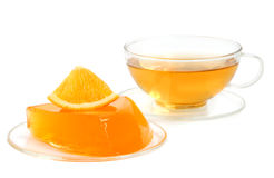 Orange jelly and tea Royalty Free Stock Images