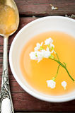 Orange jelly with white flowers on wooden background Stock Photos