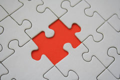 Orange jigsaw element stock photo