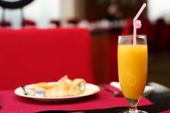 Orange juice. One cup of orange juice on dinning dable Stock Photos
