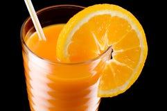 Orange juice. Close off the juice and the orange Stock Photography