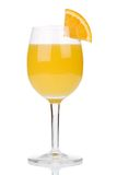 Orange juice. In a glass with a piece of orange on the glass, isolated on a white background Royalty Free Stock Images