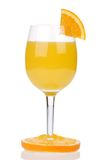 Orange juice. In a glass with a piece of orange on the glass, isolated on a white background Stock Image