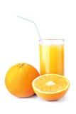 Orange juice. Ripe oranges and freshess juice on white Royalty Free Stock Photo
