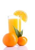 Orange Juice. Glass of orange juice and oranges with leaves on white background Royalty Free Stock Photos