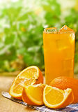 Orange juice. With orange slices on the wood surface, outdoor Stock Photography