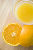 Orange and juice. Half of fresh orange and orange juice glass Stock Images