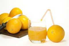 Orange juice. Oranges and orange juice in a glass Royalty Free Stock Photography