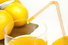 Orange juice. Oranges and orange juice in a glass Royalty Free Stock Photos