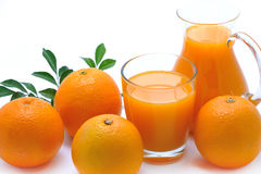 Orange juice. In glass and jug and orange Stock Photos