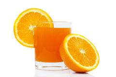 Orange Juice. In glass i oranges fruits Royalty Free Stock Photo