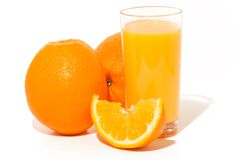 Orange juice. Glass of orange juice, and oranges on white background royalty free stock photos