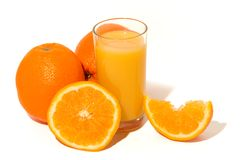 Orange juice. Glass of orange juice, and oranges on white background stock photo