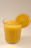 Orange Juice. Glass of orange juice, with sliced orange stock photos
