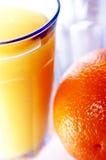 Orange Juice. Glass of orange juice and an orange royalty free stock image