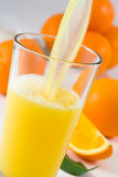 Orange Juice. Pouring fresh orange juice in the glass royalty free stock image
