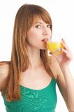 Orange juice. Beautiful woman drinks orange juice Royalty Free Stock Photo