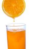 Orange juice. Pouring orange juice from orange, isolated background with clipping path Stock Photo