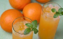 Orange juice. Fresh orange juice with ice Royalty Free Stock Images