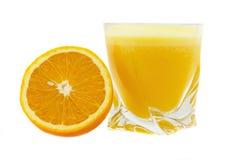 Orange juice. Glass of orange juice and orange on a white Royalty Free Stock Images