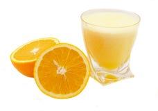 Orange juice. Glass of orange juice and oranges on a white background Royalty Free Stock Image