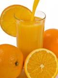 Orange Juice. A glass of cold Orange Juice and Oranges stock photo