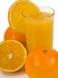 Orange Juice. A glass of cold Orange Juice and Oranges royalty free stock photos