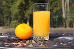 Orange juice. Orange and juice on table outdoor Stock Images