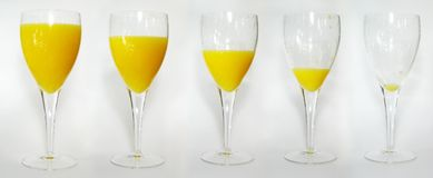 Orange Juice. Series of Orange Juices being drunk stock photos