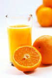 Orange juice. On the white background Royalty Free Stock Photos