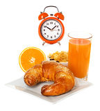 Orange juice, alarm clock Stock Photos