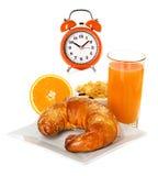 Orange juice, alarm clock Stock Photos