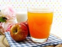 Orange juice and apple on sweet polka dot background Stock Photography