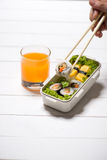 Orange juice and bento box with different food, fresh veggies an Stock Photos