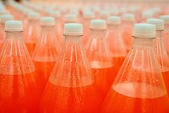 Orange juice beverage plastic bottle in factory Stock Photos