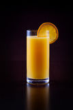 Orange juice on black Royalty Free Stock Image