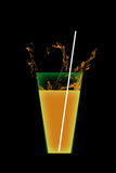 Orange juice. On black background Stock Photos