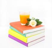 Orange juice  on book Royalty Free Stock Photo