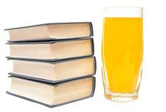 Orange juice and books Stock Photo