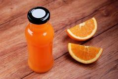 Orange juice in the bottle Stock Photos