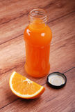 Orange juice in the bottle Stock Photo