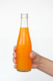 Orange juice bottle in hand Royalty Free Stock Image