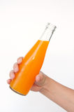 Orange juice bottle in hand Royalty Free Stock Photos