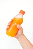 Orange juice bottle in hand Stock Photos