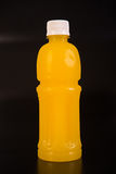 Orange juice bottle. Isolated on black background Stock Photo