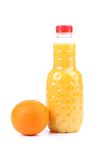 Orange and juice in bottle. Royalty Free Stock Photos