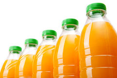 Orange juice. Bottles with fresh orange juice on white background Stock Photography