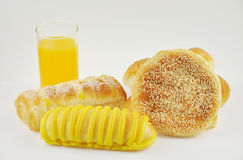 Orange juice and bread Stock Images