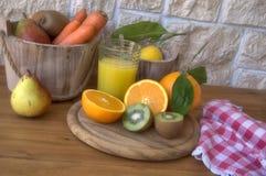 Orange juice and carrots Royalty Free Stock Photos